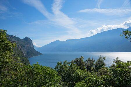 idyllic landscape lake garda with green vegetation, lakeside west, lombardy italy