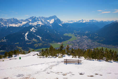 lookout point with bench at Wank mountain, view to zugspitze and bavarian alps, early winter time,