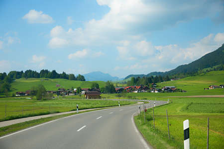 country road in allgau landscape from Oberstdorf to Rubi tourist resort, germany