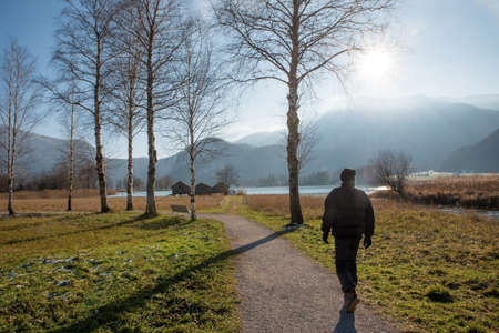man on the walkway from Schlehdorf to lake Kochelsee, upper bavarian landscape