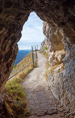 adventurous trail at Wendelstein mountain, view out of a rocky arch. tourist attraction in the bavarian alps.