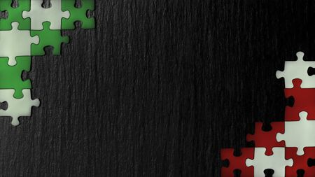 Green, red and white puzzles in the corners on a black slate stone background. Colors on the flag of Italy, Western Sahara, United Arab Emirates, Mexico, Hungary, Madagascar. A frame with an empty space for your description. 免版税图像
