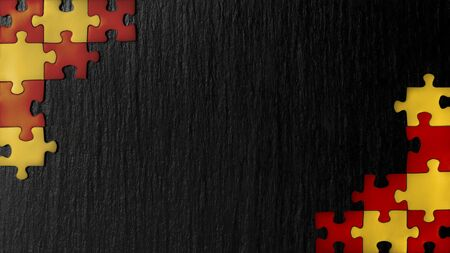 Red and yellow puzzles in the corners on a black slate stone background. The colors appearing on the flags: Germany, Belgium, Uganda, Vietnam, Spain, Kyrgyzstan. A frame with an empty space for your description. 免版税图像