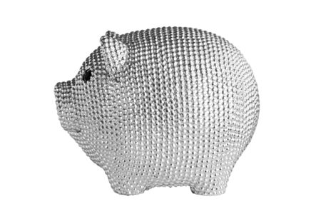 Silver metal piggy bank with black eyes isolated on white background. Side view.