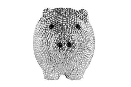 Silver metal piggy bank with black eyes isolated on white background. Front view. 免版税图像