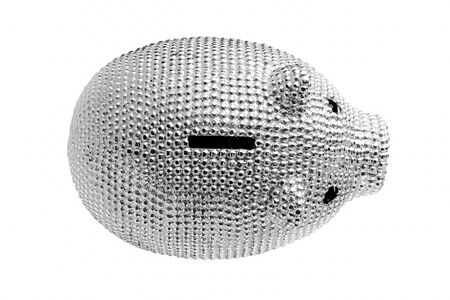 Silver metal piggy bank with black eyes isolated on white background. Top view.