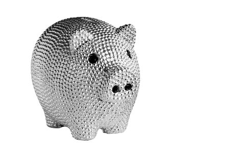 Silver metal piggy bank with black eyes isolated on white background.