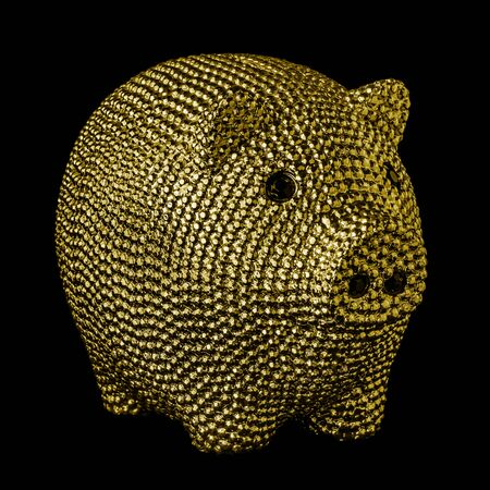 Gold piggy bank with black eyes isolated on black background. Stock fotó