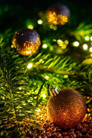 Christmas landscape with Christmas balls, chain, branches and lights. Beautiful colorful blurry christmas background.