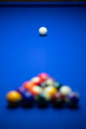 Colorful balls on a blue pool table. Set up and ready to play. Selective focus. 免版税图像