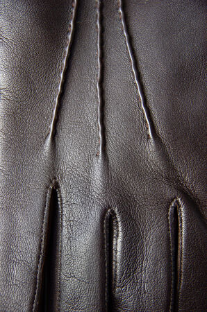 leather glove: Close up of black leather glove Stock Photo