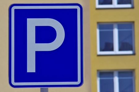 prefabricated house: Blue parking sign and prefabricated house