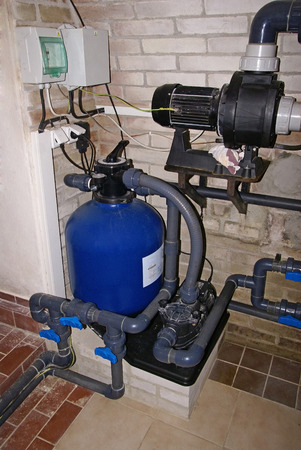 water filter: Swimming pool filtration system at basement