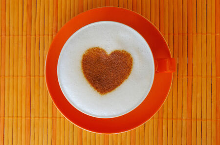 Cappuccino with heart ornament made of cinnamon