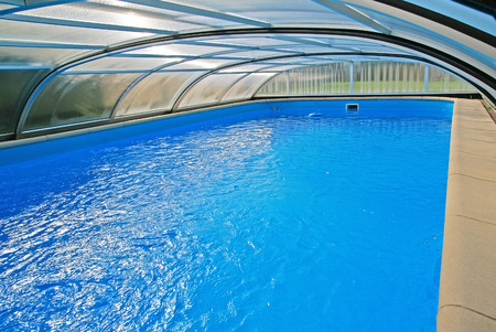 shelter: Swimming pool with a roof Stock Photo