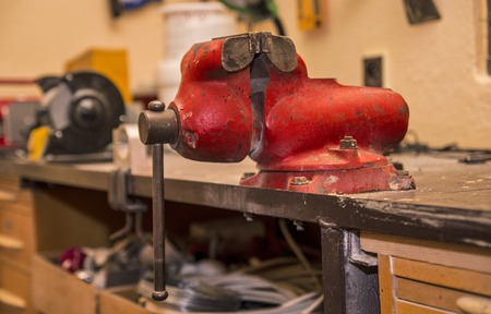 vise: Red vise in the workshop