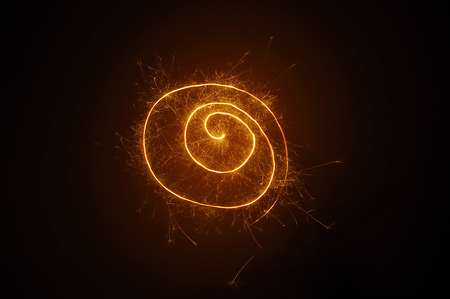 trajectory: Spiral painted with sparkler on a black background