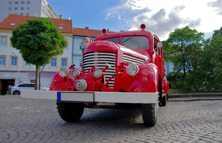 antique fire truck: Front view of oldfashioned red fire truck. Stock Photo
