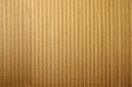 Close up of brown cardboard texture. Seamless carton background from paper box