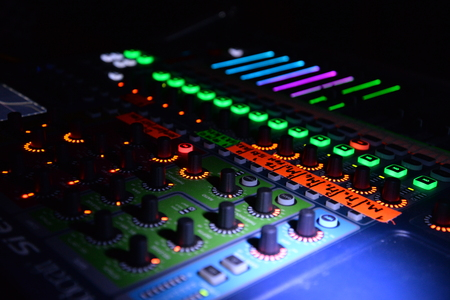 Close up of lighting buttons and sliders on mix pult. Music and sound theme. Stock Photo