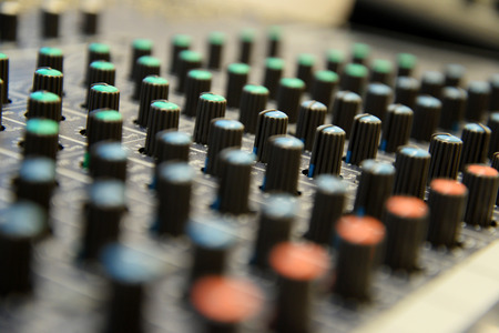 Sound mixer close up. Controllers on professional audio mix pult.
