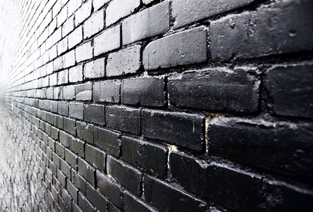 Close up of black wall. Graphic resource for various purposes. Black wall texture.