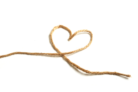 Top view of a rope in a heart shape isolated on white background.