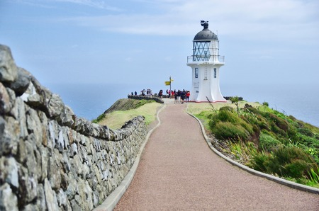 Beautiful view of white lighthouse on Cape Reinga in New Zealand. New Zealands must do activity.
