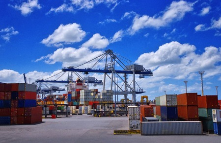 View of colorful containers and cargo cranes in the port. International cargo shipping concept. Stock fotó