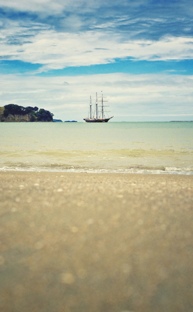 View of the sailing boat on the sea from the beach.