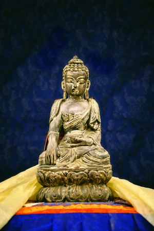 Buddha sculpture. Buddha statue made of gold. Buddhism religion concept.