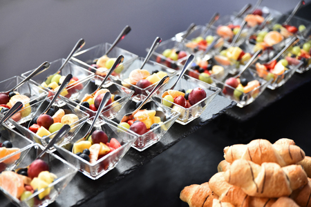 Fruit salad in small glass bowls. Luxury catering for an event.