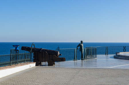 Balcony of Europe (Balcon de Europa) in Nerja, Spain. Landscape with statues on a famouse place, sea and blue sky in the background.
