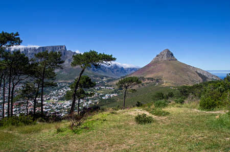View of a famous hill in Cape Town called Lion's Head. Sunny day and blue sky in the background.