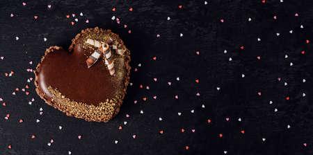 Homemade heart shaped chocolate cake. Love cake. Romantic dessert. Cake in the form of heart.