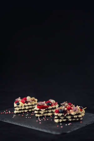Heart shaped layered cake with fruit. Romantic present. Sweet Valentine. Bakery or confectionery concept.