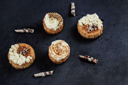 Top view of small cheesecakes. Mini chessecakes with creamy topping and chocolate shavings. Stock fotó