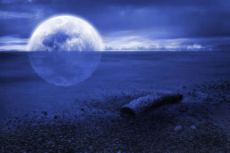 Reflection of the moon at sea  photo