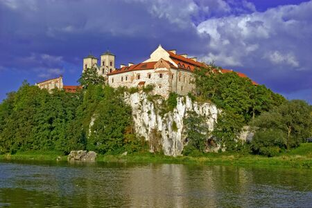 Benedictine Abbey on the rocky hill by the Vistula river in Tyniec against a blue sky Editorial