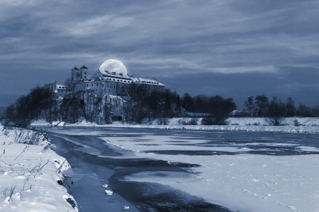 Big moon over the Benedictine Abbey  in Tyniec, near Krakow - winter view