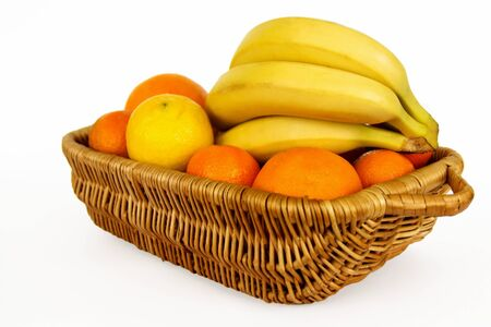 Fresh  fruits  in the basket  Isolated on a white