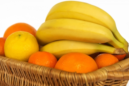 Ripe fresh  fruits  in the basket  Isolated on a white