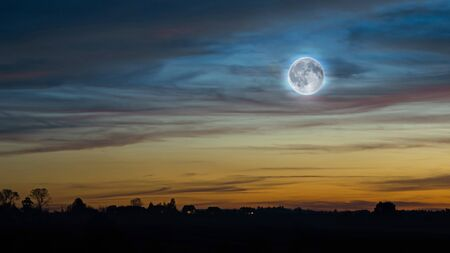 Sunset sky with the full moon