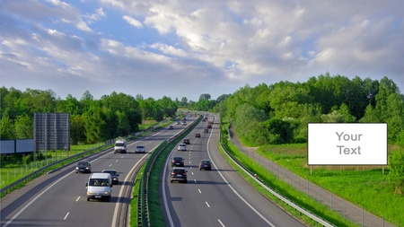 blank billboard: Billboards on the highway with lots of cars traffic Stock Photo
