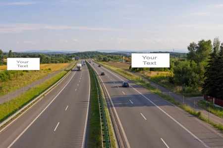 Two billboards on the highway