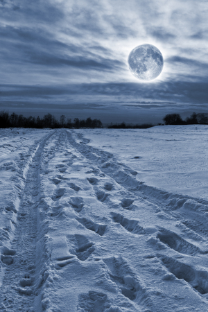 Moon over the snow-covered road  Stock Photo
