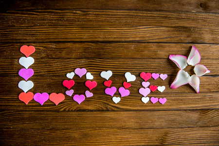 heart shaped stuff: Word Love from the hearts on a wooden background. Valentines Day Stock Photo