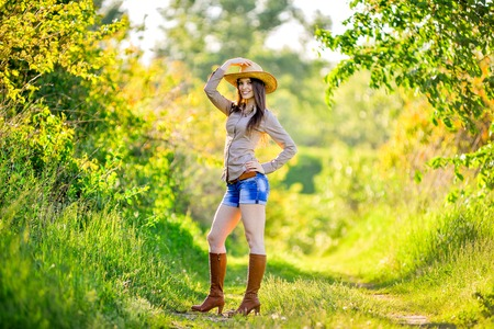 young beautiful girl in a cowboy hat, country style
