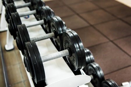 kilos: Various dumbbells in gym. Various dumbbells in gym. Stock Photo
