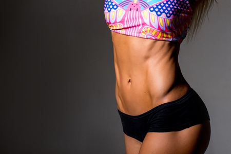 six girl: close up picture of woman trained abs. close up picture of woman trained abs
